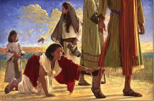 donna che tocca mantello di Gesù